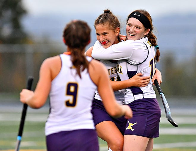 Eastern York's Isabelle McKenzie, right, and Donnelly Bankowski celebrate a 2-1 win over Gettysburg during field hockey action at Eastern York Senior High School in Lower Windsor Township, Wednesday, Oct. 28, 2020. Dawn J. Sagert photo