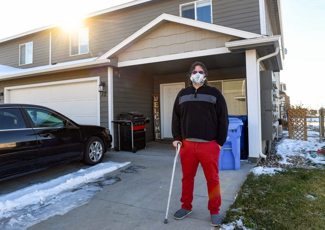 Caleb Van Vooren stands outside his home on Wednesday, October 28, in Sioux Falls.