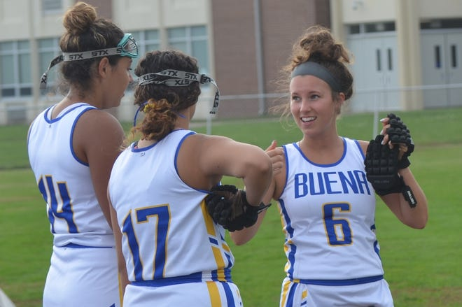 Buena field hockey players Abby Cuello and Hailee Quiles listen to senior Karlie Byrd during warmups before facing Bridgeton.