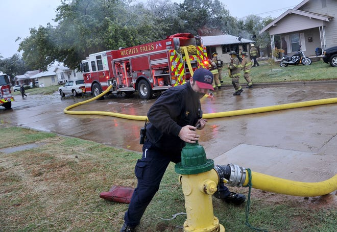 Wichita Falls firefighters worked to control a structure fire at an abandoned house on Buchanan Street Tuesday afternoon.