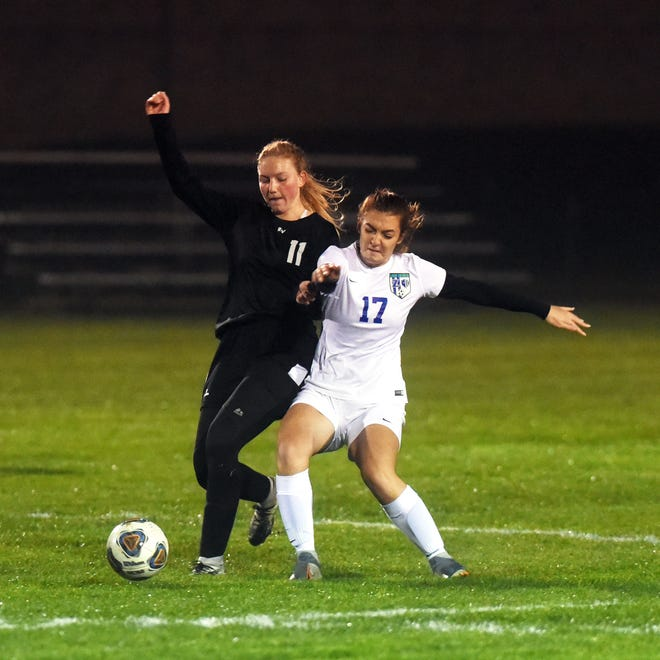 River View's Aleigha Hardesty, left, and Allie Walker go after the ball during a 1-0 win against Zanesville on Tuesday night in a Division II district semifinal in Warsaw.