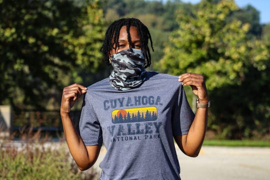 Ebony Hood shows off a Cuyahoga Valley National Park T-shirt before cycling 12 miles of the Ohio and Erie Towpath Trail, which follows the historic Ohio and Erie Canal in September 2020.