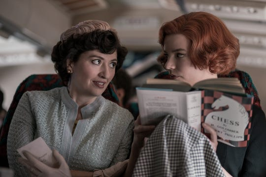 "Marielle Heller as Alma Wheatley and Anya Taylor-Joy as Beth Harmon in ""The Queen's Gambit."""