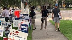 Voters say armed guards stood near an early voting site in St. Petersburg, Florida on Oct. 21, 2020.