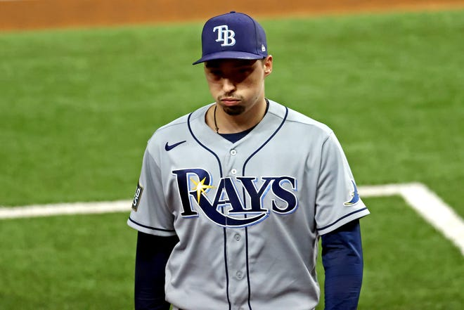 Blake Snell reacts as he's taken out of the game in the sixth inning.