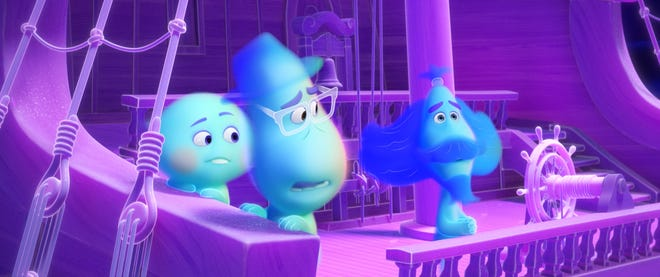 """""""Soul"""" (Dec. 25, Disney+): Middle-school band teacher Joe Gardner (voiced by Jamie Foxx, center) journeys through the afterlife and meets a precocious soul (Tina Fey) and a spiritual sign twirler (Graham Norton) in Disney/Pixar's animated comedy."""