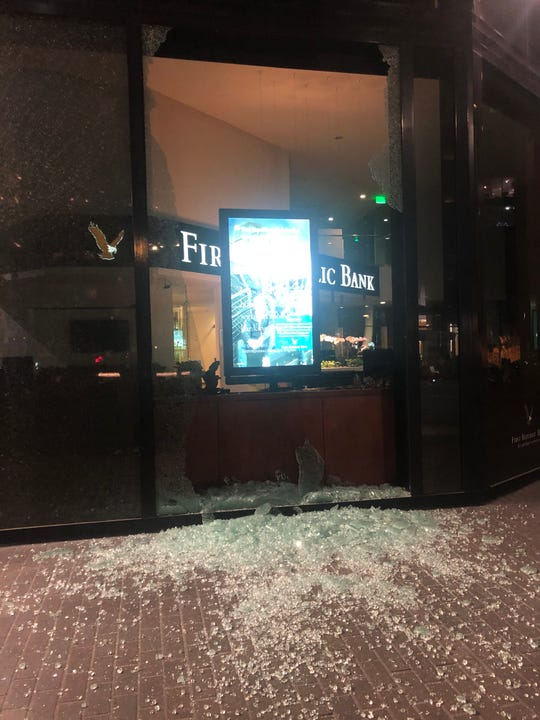 A window is shattered at a First Republic Bank in Los Angeles during the celebration of the Dodgers' World Series victory.