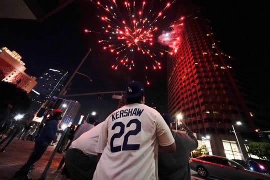 Baseball fans celebrate downtown after the Los Angeles Dodgers won the World Series over the Tampa Bay Rays.