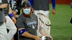 Los Angeles Dodgers third baseman Justin Turner celebrates with the Commissioner's Trophy after winning the World Series.