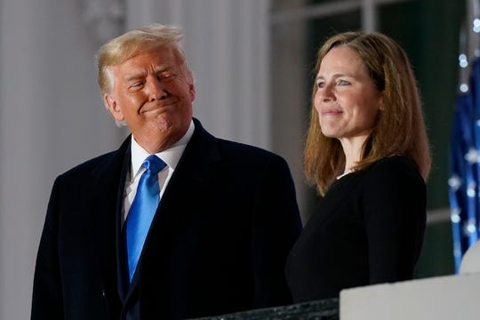 President Donald Trump and Justice Amy Coney Barrett at the White House in Washington, D.C., on Oct. 26, 2020.