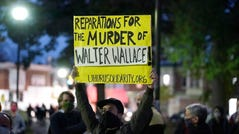 Protesters gather for a march on Tuesday night in Philadelphia following the police shooting of Walter Wallace, a Black man who was killed after officers yelled at him to drop his knife.
