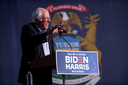 Sen. Bernie Sanders, I-Vt., speaks to the crowd at a car rally campaign event for Democratic presidential nominee Joe Biden on Oct. 5, 2020, in Warren, Mich.