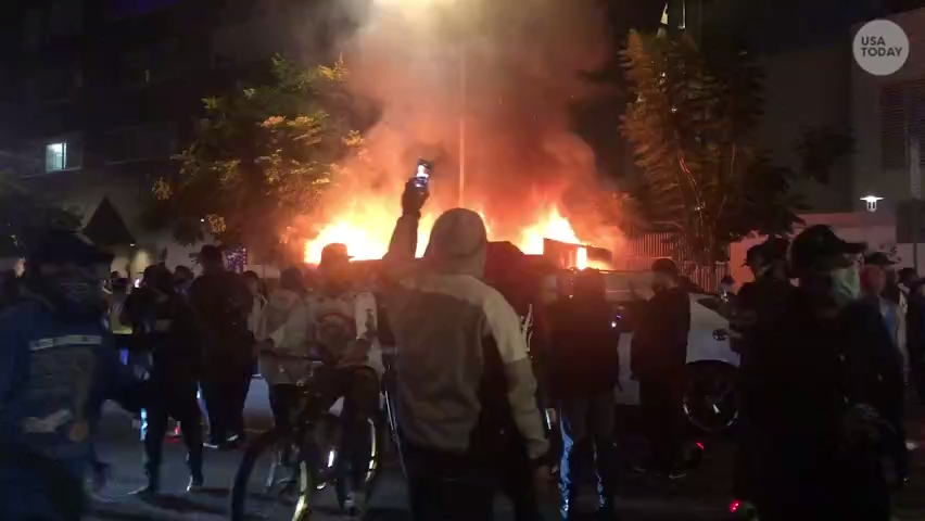 From fireworks to dumpster fires, Dodgers fans celebrate in the streets