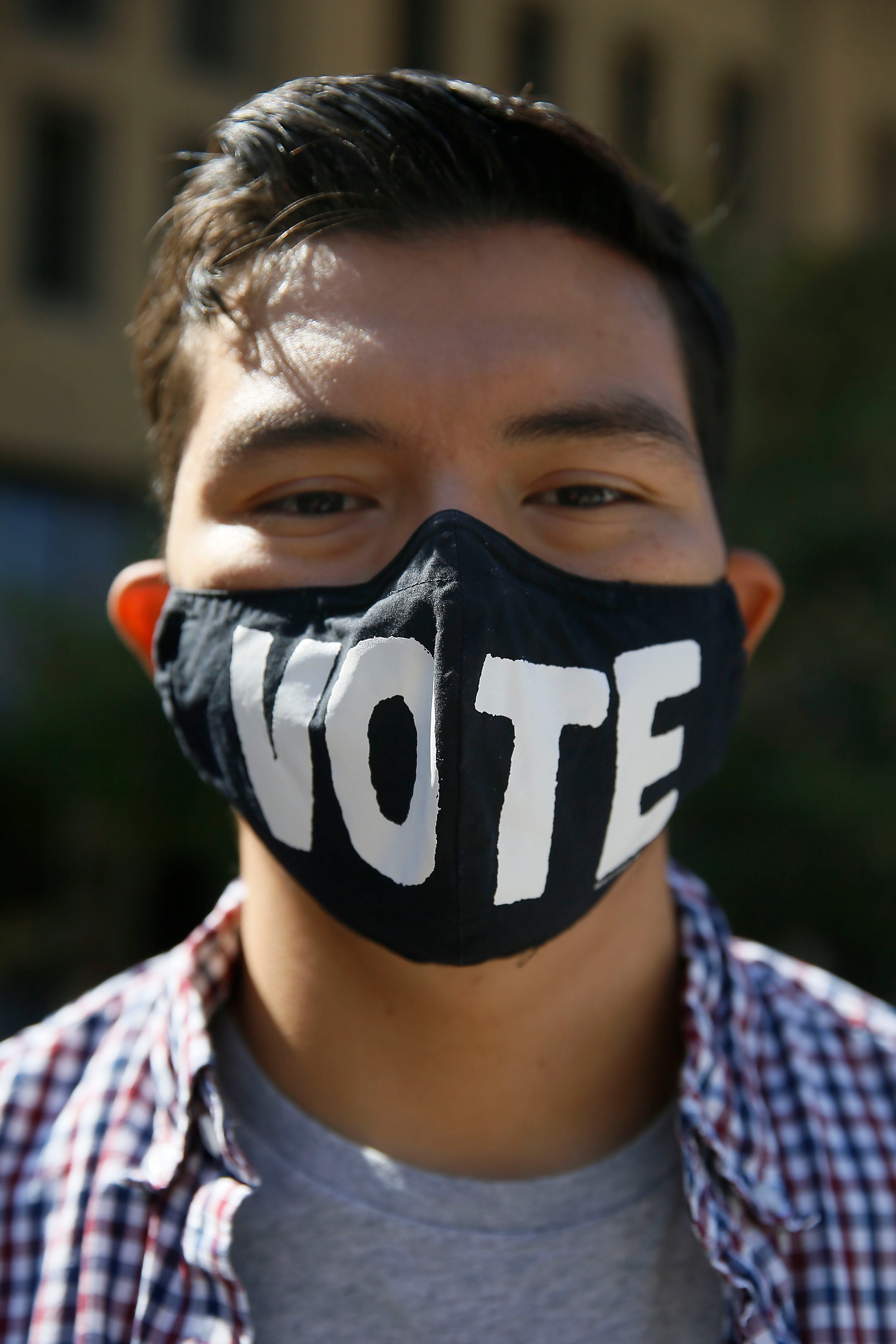 Student wears a mask that reads