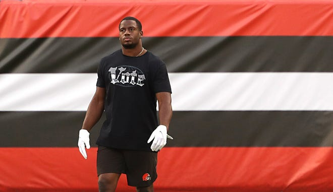 """Cleveland Browns running back Nick Chubb (24) wears a shirt that says """"vote"""" before an NFL football game at FirstEnergy Stadium, Thursday, Sept. 17, 2020, in Cleveland, Ohio. [Jeff Lange/Beacon Journal]"""