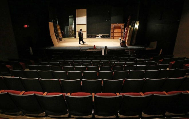 Tech Director Richard Morris walks on new flooring on the Weathervane Playhouse stage June 3 in Akron. The theater has been closed since March.