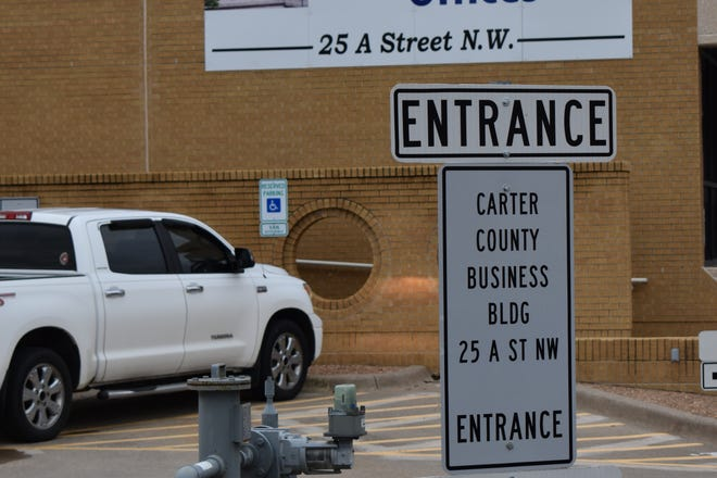 Signs near the Carter County administration building direct early voters to the election board offices Thursday. Early voting in Oklahoma continues through Saturday.