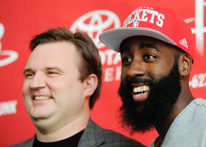 Rockets GM Daryl Morey, left, and guard James Harden smile for the cameras after Houston acquired Harden from the Thunder in 2012.