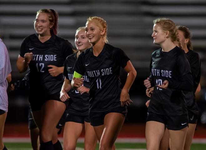 South Side girls soccer team are all smiles after their playoff win over Serra Catholic at Freedom High School.