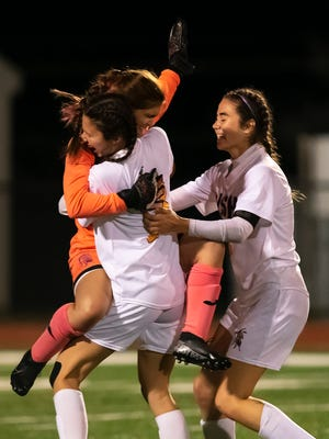OLSH girls soccer players celebrate their win over Freedom.