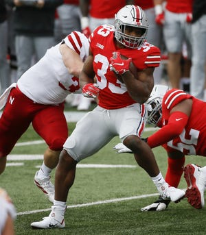 Ohio State's Master Teague III tries to find running room against Nebraska.