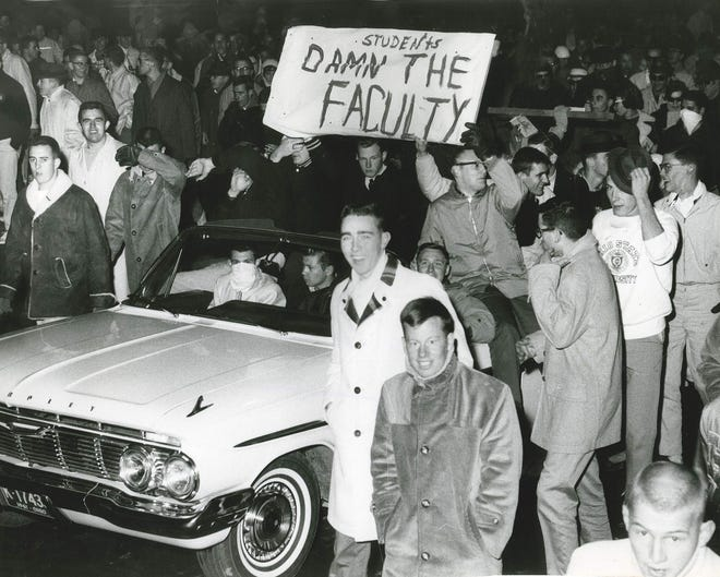 Ohio State students protest a vote by the university's faculty council in late November 1961 to turn down an invitation to play in the Rose Bowl.