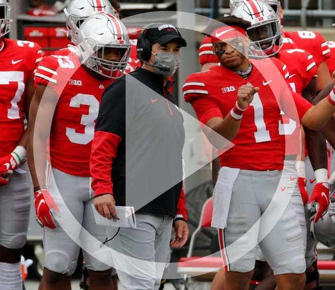 Ohio State head coach Ryan Day, left, talk with quarterback Justin Fields during the second half of their NCAA college football game against Nebraska Saturday, Oct. 24, 2020, in Columbus, Ohio. Ohio State defeated Nebraska 52-17.