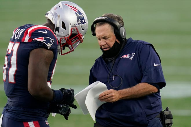 """New England Patriots head coach Bill Belichick, right, gives instructions to linebacker Ja'Whaun Bentley in the first half of Sunday's game against the San Francisco 49ers in Foxboro. """"We certainly need to improve from where we are, and we will,"""" Belichick said."""