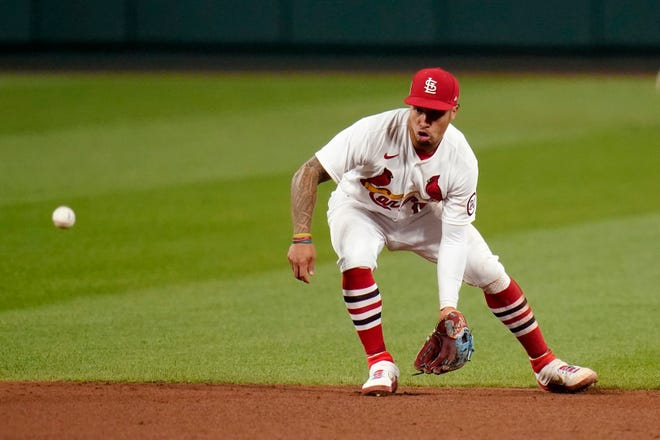 St. Louis Cardinals second baseman Kolten Wong handles a sharp grounder by Cincinnati Reds' Nick Castellanos during a game Sept. 11 at Busch Stadium in St. Louis. Wong, a first-round pick in the 2011 draft, made his big league debut in 2013 and spent his first eight seasons with St. Louis.