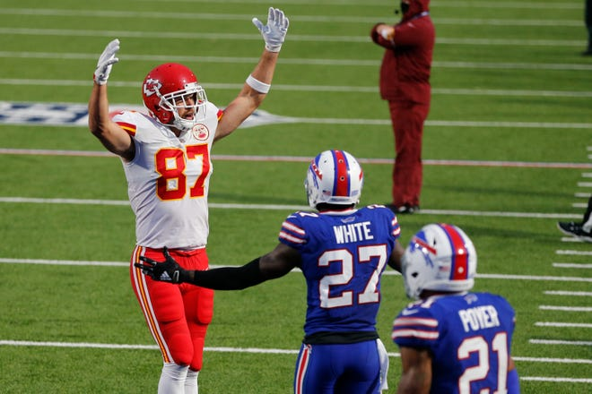 Kansas City Chiefs' Travis Kelce, left, celebrates his touchdown during a game against the Buffalo Bills on Oct. 19 in Orchard Park, N.Y.