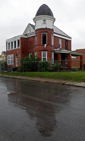 A Queen Anne house at 1235 W. Broad St. was used for fire training recently, but officials with the Columbus Landmarks Foundation and Franklinton Board of Trade want it saved because it is the last single-family house still standing on Broad in that part of Franklinton.
