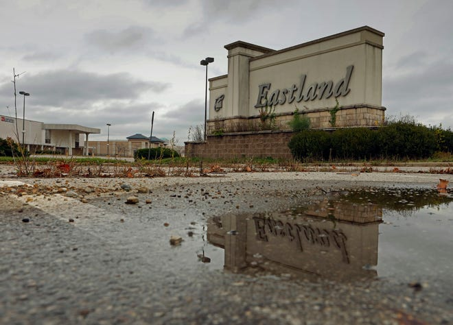 The sign on the north side of Eastland Mall is reflected in an empty parking lot. The 43232 ZIP code area, which includes the mall, leads the city in both eviction filings and requests for rental assistance during the COVID-19 outbreak.
