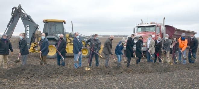 Gov. Tim Walz, AIC board members and legislators prepare to toss dirt.