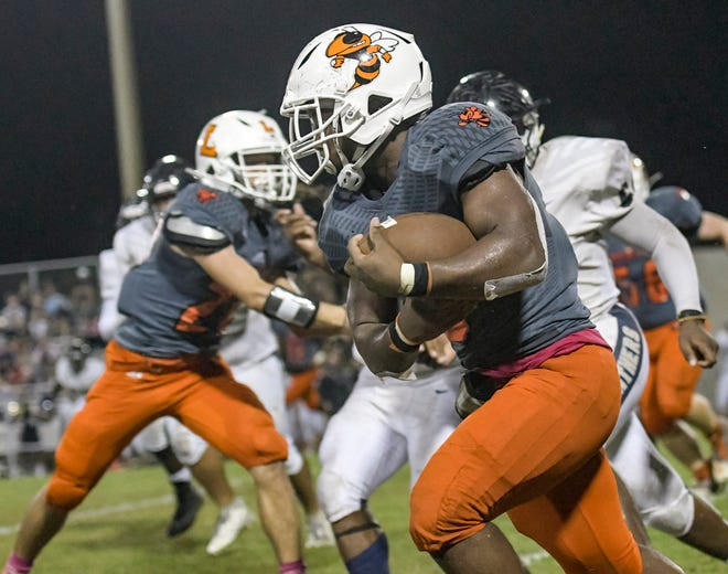 Leesburg's Isaiah Byrd makes a carry during last year's game against Eustis at H.O. Dabney Stadium in Leesburg. The teams meet for the 77th time Friday in Eustis. [PAUL RYAN / CORRESPONDENT]