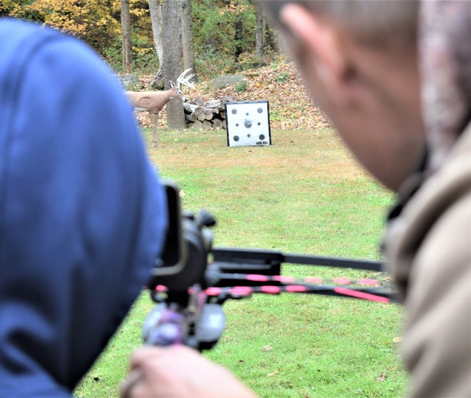 Kaden Achor of Indiana, a participant in last year's Hunt for Hope, and his guide set their sights in on the target in preparation for the hunt.