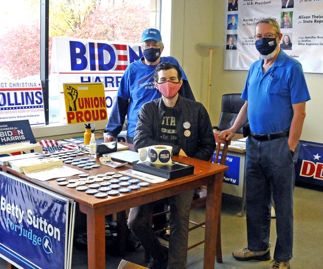 Wayne County Democratic Party Executive Committee member Chuck Leming, volunteer Cormac Kelly, and party Chair Bill Bailey work in the party headquarters in downtown Wooster on Thursday.