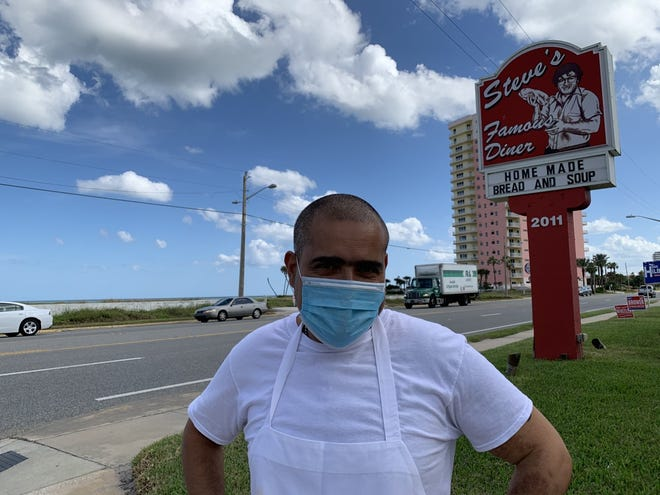Christos Mavronas, owner of Steve's Famous Diner at 2011 N. Atlantic Ave. in Daytona Beach, stands across the street from the vacant beachfront lot that used to be the site of the old Beachcomber Oceanfront Inn, on Thursday, Oct. 29, 2020. An Orlando company called Westgate Resorts on Friday closed its $3.5 million purchase of the lot on Friday after submitting the top bid in an online auction.