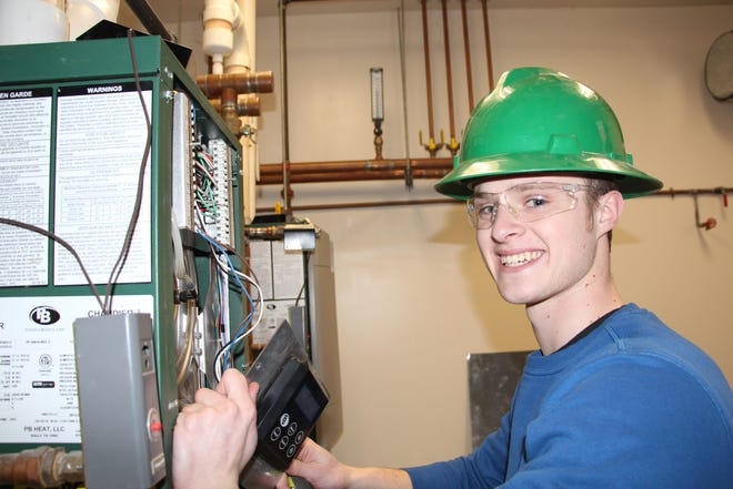 Alfred State College is ranked in the top 3 for schools offering heating, ventilation, and air conditioning by US News & World Report in its Best Colleges list. Pictured is Collin Stauffer, of LeRoy, a 2020 graduate of Alfred State's HVAC program.