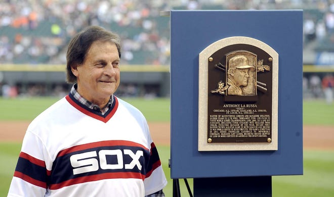 Once and future Chicago White Sox manager Tony La Russa stands with his Baseball Hall of Fame plaque before the second game of an Aug. 30, 2014, doubleheader against the Detroit Tigers in Chicago. La Russa is returning to manage the Chicago White Sox 34 years after they fired him, the team announced Thursday.