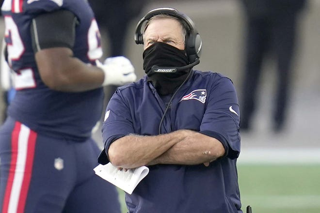 New England Patriots coach Bill Belichick watches from the sideline during the first half of Sunday's game against the San Francisco 49ers in Foxborough, Massachusetts.