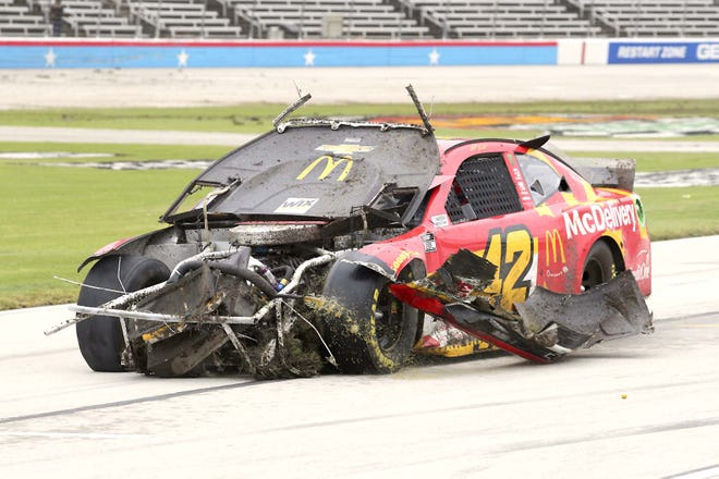 Matt Kenseth drives his damaged car during the NASCAR Cup Series race at Texas Motor Speedway Wednesday.