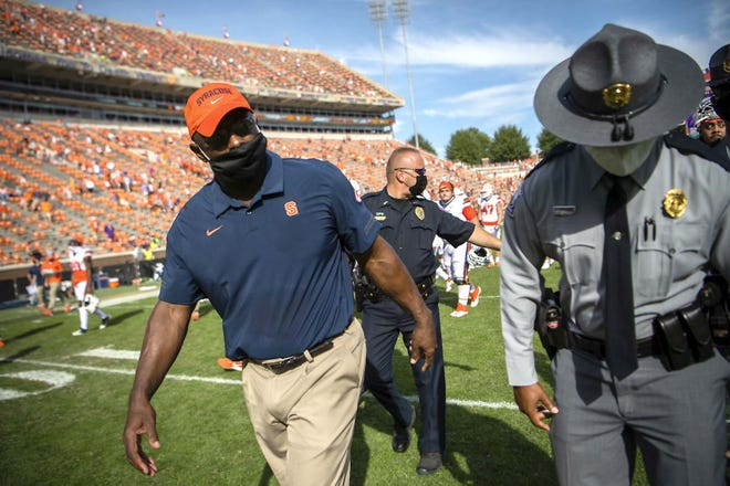 Syracuse coach Dino Babers walks off the field after Saturday's loss at Clemson.