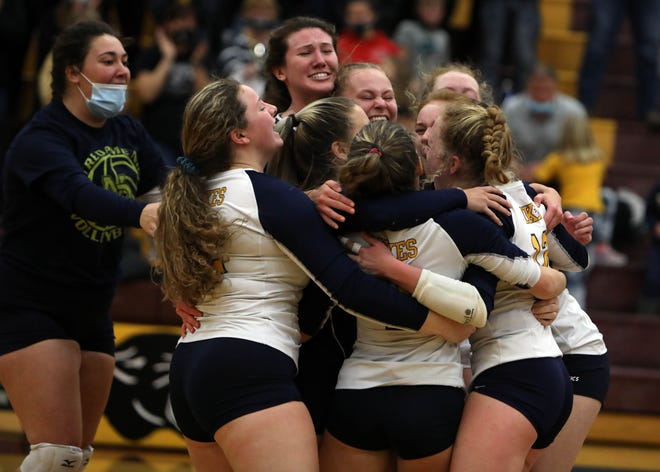 Notre Dame High School players celebrate their Class 1A Region 8 final victory over WACO High School Wednesday at Mount Pleasant.