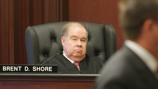 In this July 8, 2015 file photo, Judge Brent Shore listens to a defense attorney during court proceedings in a Duval County Courtroom.