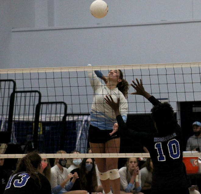 Ponte Vedra's Kendall Mignerey (7) prepares for the spike as Ridgeview's Lauren Hines (13) and Haley Robinson (10) defend during Wednesday's FHSAA Region 1-5A semifinal.