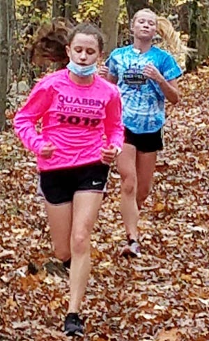 Sophomore Katherine McMenemy, Quabbin's top runner, navigates a tricky part of Quabbin's cross country course as the Panthers' No. 3 runner, junior Emma Gatulis, follows behind her during a recent practice.