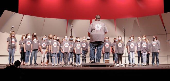 Choir Director Samuel Teal directs the Sixth Grade Girls Choir on Tuesday night.