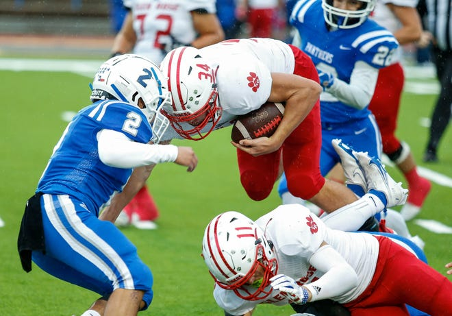 TRISTAN: Glen Rose running back Tristan Black (34) battles for yardage in a game earlier in the year against Fort Stockton.