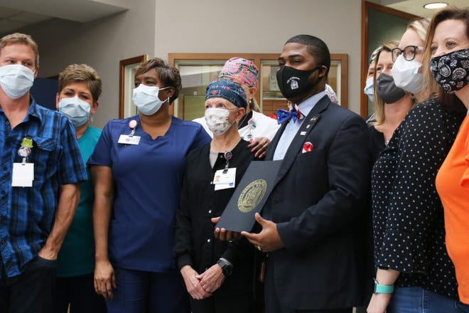 Kinston Mayor Dontario Hardy poses with respiratory therapists at UNC Lenoir Health Care Thursday, October 29, after Hardy presented the hospital with his proclamation from earlier this month, declaring October in Kinston as Respiratory Care Practitioners Month amid COVID-19. [Brandon Davis/Kinston Free Press]