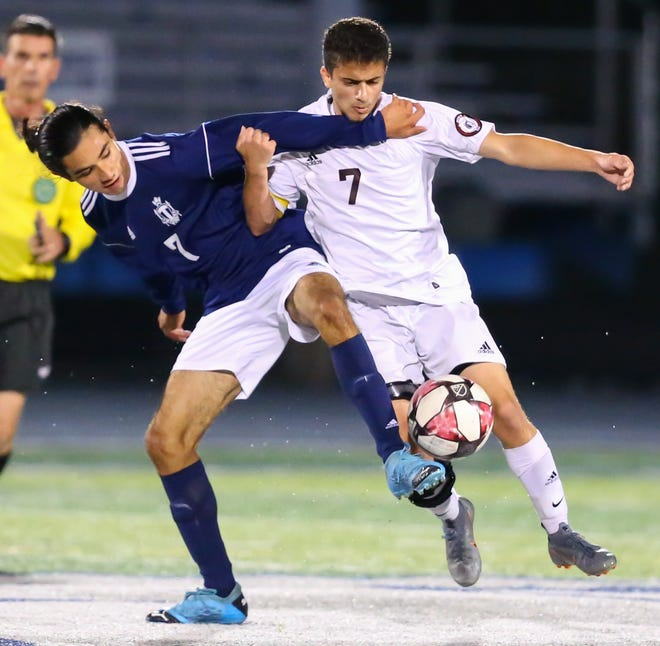 Twinsburg forward Daniel Silva fights for the ball during a game with Stow-Munroe Falls earlier this season.
